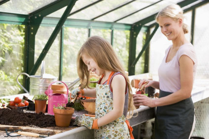 Mother and Daughter Enjoy Quiet Time in the Greenhouse